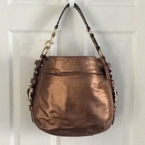 Coach leather purse in bronze with gold hardware.